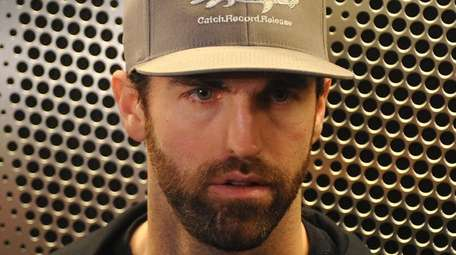 Andrew Ladd speaks with the media after Islanders
