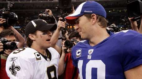 Drew Brees and Eli Manning after the Saints'