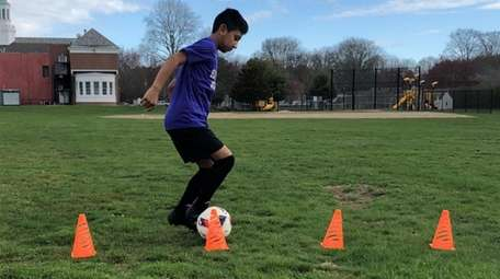 Kidsday reporter Helio Paucar practices his soccer moves.