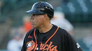 Ducks manager Kevin Baez heads onto the field