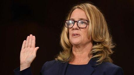 Christine Blasey Ford is sworn in to testify