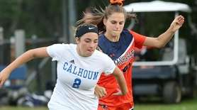 Calhoun's Lily Conlon moves the ball forward during