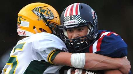 Nick LiCalzi #33 of South Side, right, fights