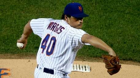 Mets pitcher Jason Vargas delivers during the first