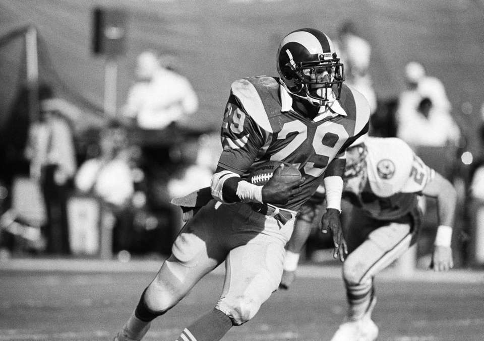 ERIC DICKERSON, LOS ANGELES RAMS, 1984: 2,105 YARDS