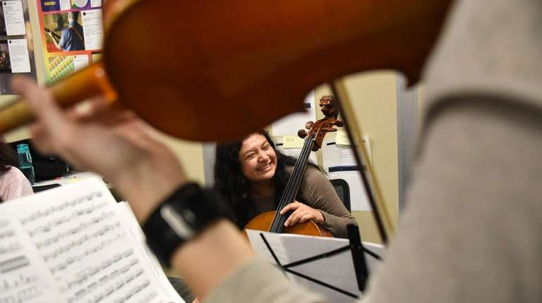 Cellist Jennifer Calderon, a student musician from Copiague,