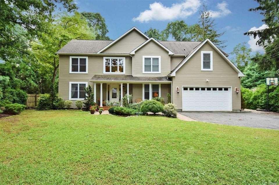 This Northport Colonial includes four bedrooms and 2