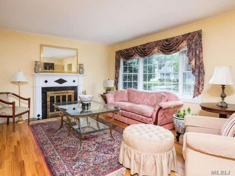 The living room features hardwood floors and a