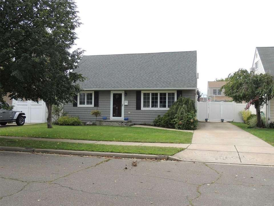 This Wantagh Cape includes three bedrooms and one