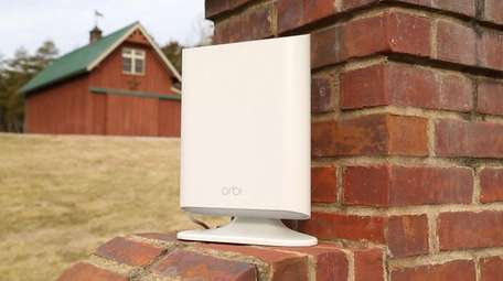 Netgear's weather-resistant Orbi Outdoor Satellite, along with an