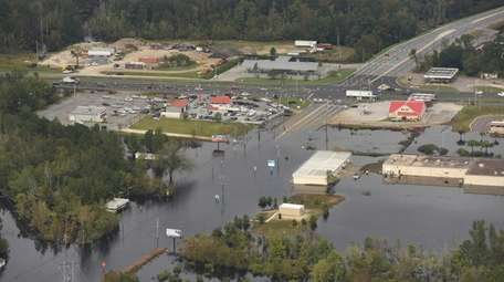Flood waters from the Neuse River cover the