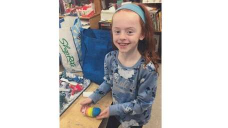 Kidsday reporter Beatrice McKeon with a painted rock.