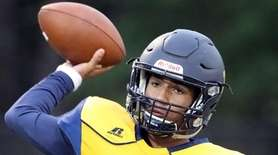 Shoreham-Wading River quarterback Xavier Arline (7) warms up