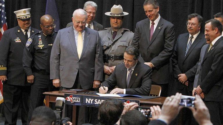 Gov. Andrew M. Cuomo signs the NY Safe
