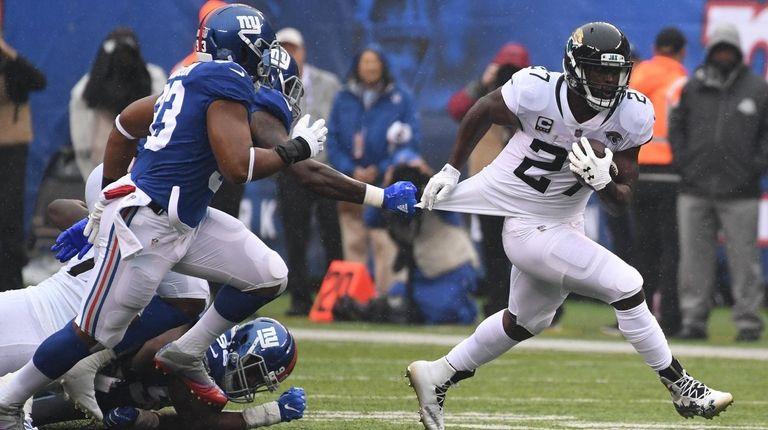 Jacksonville Jaguars Running Back Leonard Fournette Runs Ahead
