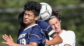 Huntington's Carlos Reyes goes for the header with