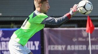 Bellport goalkeeper Sam Hampson makes the save against