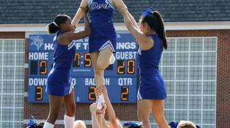 Port Washington cheerleaders perform their halftime routine during