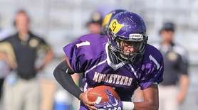 Central Islip's Davyne Goode runs the ball in