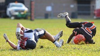 Jarell Brown #7 of East Rockaway tackles Daniel