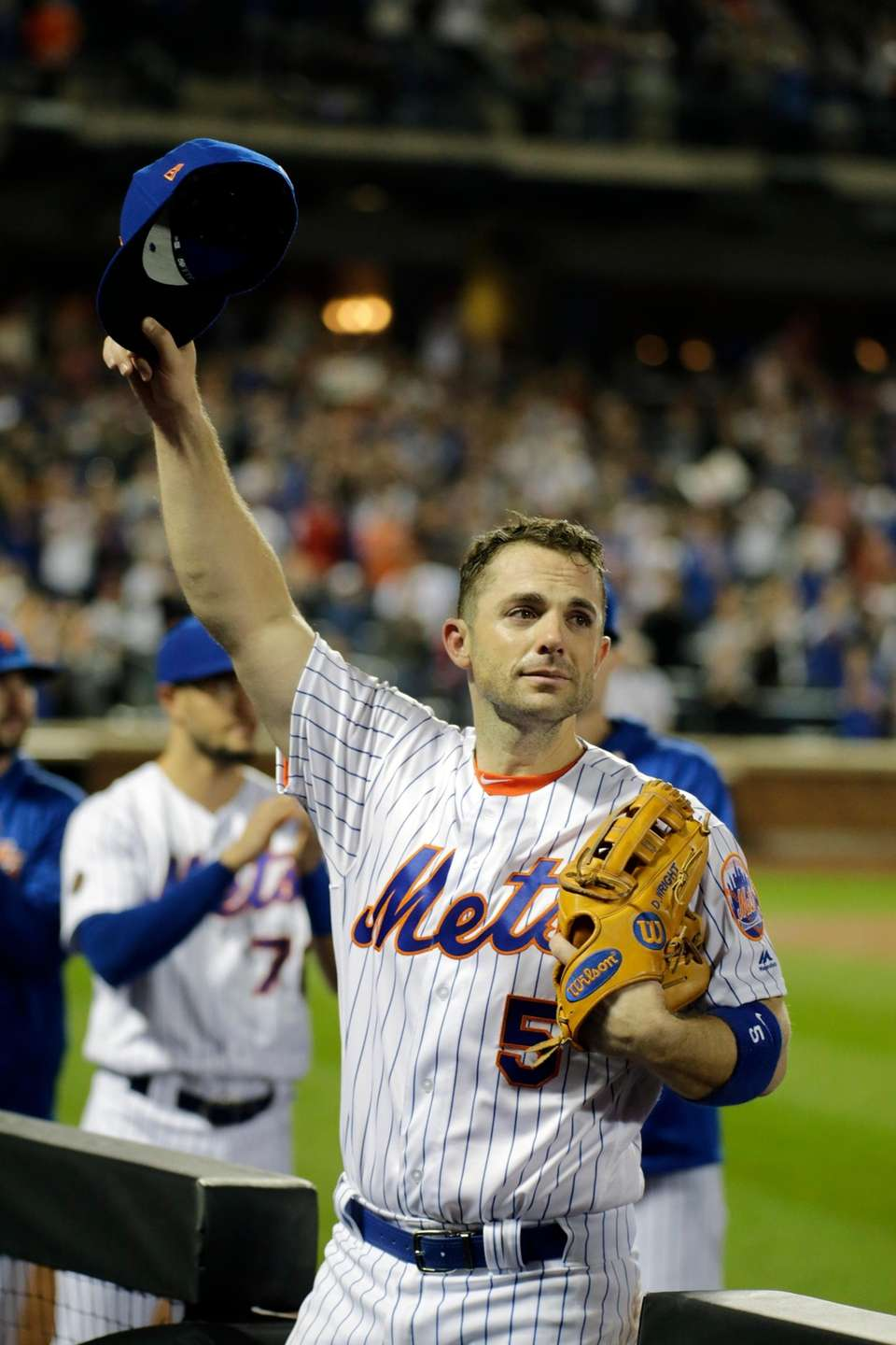 Mets third baseman David Wright leaves the field