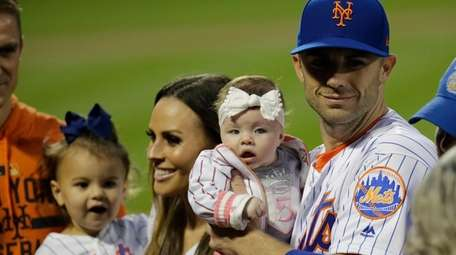 David Wright poses with his family during pregame