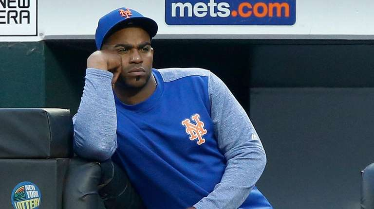 Yoenis Cespedes of the Mets looks on from