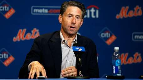 Mets COO Jeff Wilpon speaks to the media