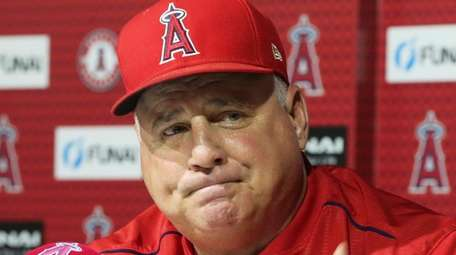 Los Angeles Angels manager Mike Scioscia announces that