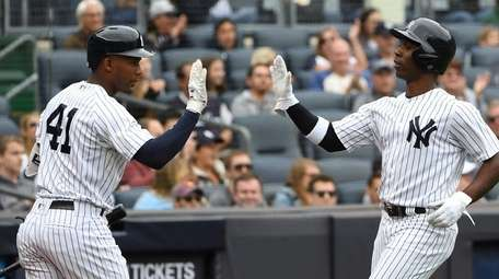 Yankees third baseman Miguel Andujar and Andrew McCutchen
