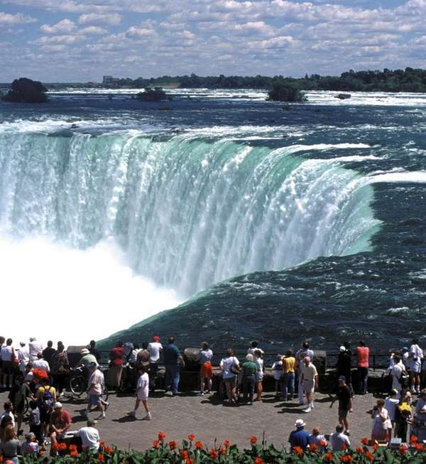 Tourists at an overlook of Horseshoe Falls on