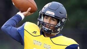 Shoreham-Wading River quarterback Xavier Arline warms up on