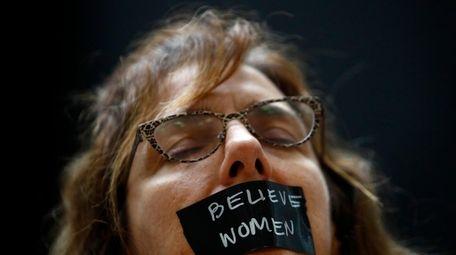 A protester demonstrates ahead of Thursday's Senate Judiciary