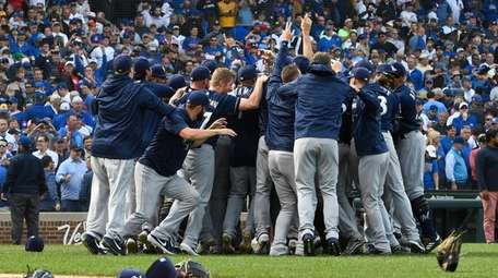 Brewers players celebrate after defeating the Cubs at