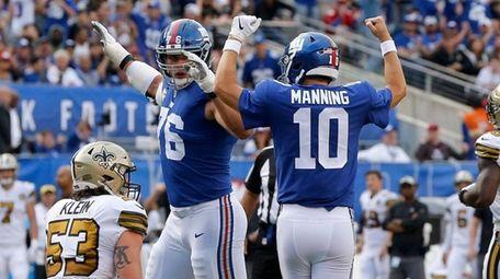 Giants quarterback Eli Manning celebrates with teammate Nate