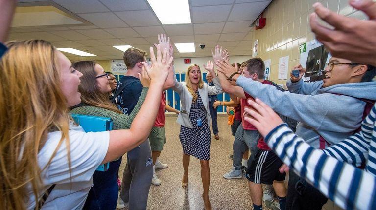 John Glenn High School principal Carisa Burzynski celebrates