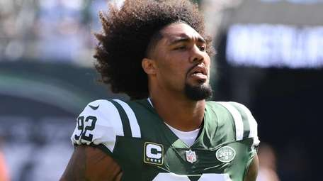 Jets defensive lineman Leonard Williams looks on from
