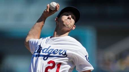 Dodgers starting pitcher Walker Buehler delivers against the