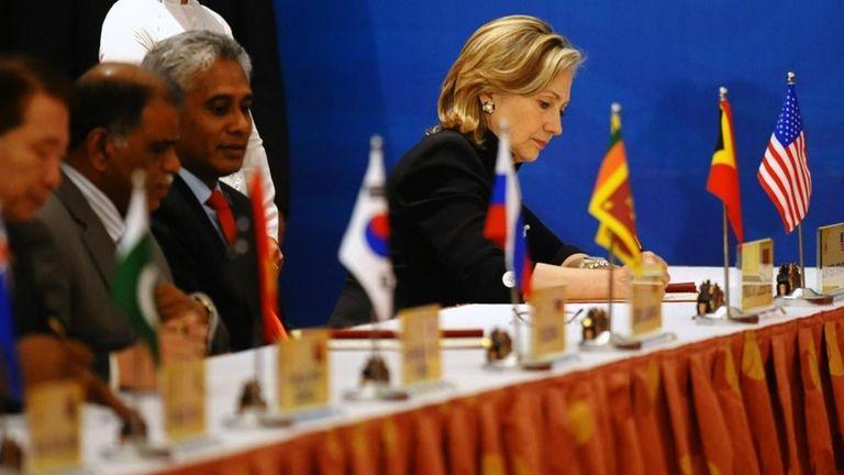 U.S. State Secretary Hillary Clinton signs a Treaty