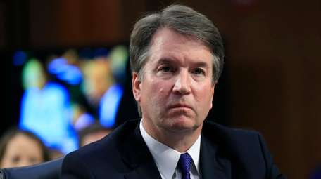 Supreme Court nominee Brett Kavanaugh, listens to Sen.