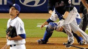 New York Mets' Jason Bay hits a three-run