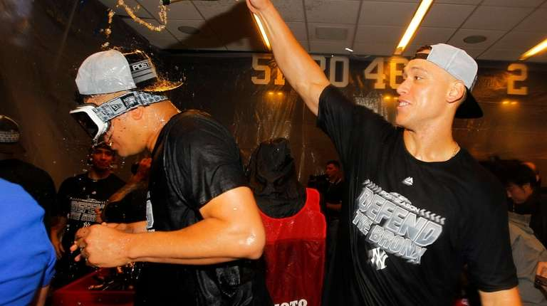 Aaron Judge of the Yankees dumps champagne on