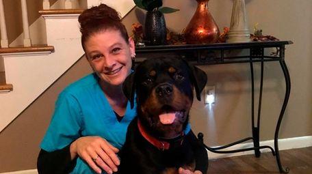 Tina Visintin and Vito, a Rottweiler, at her