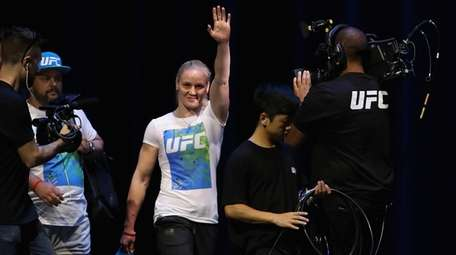 Valentina Shevchenko walks onto the stage and up