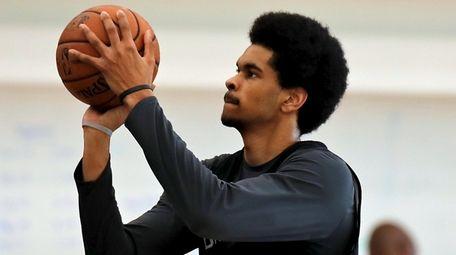 Nets center Jarrett Allen takes practice shots during