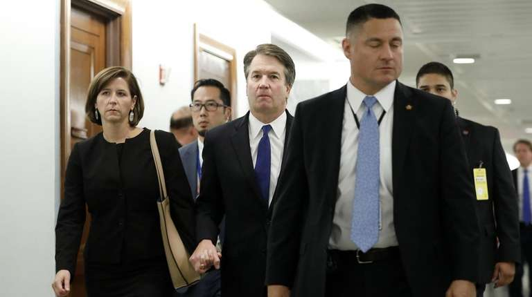 Brett Kavanaugh (center) and his wife, Ashley Kavanaugh,