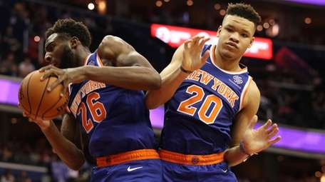 The Knicks' Mitchell Robinson and Kevin Knox go