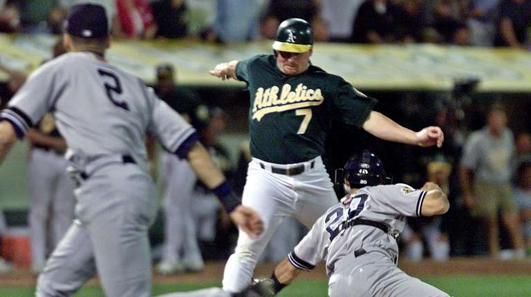 The Athletics' Jeremy Giambi is tagged out at