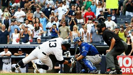 Alex Rodriguez falls after getting hit by a