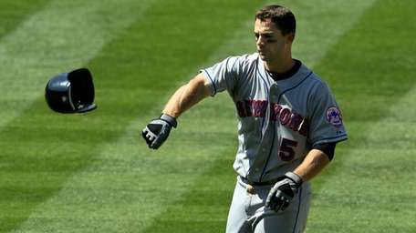 David Wright tosses his helmet after flying out